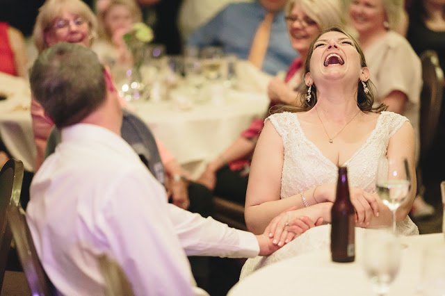 Bride laughing in Wedding Reception